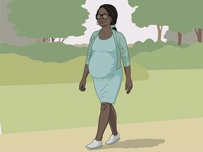 A pregnant woman walking.