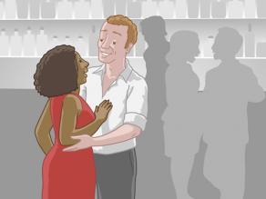 Een man en een vrouw flirten in een bar