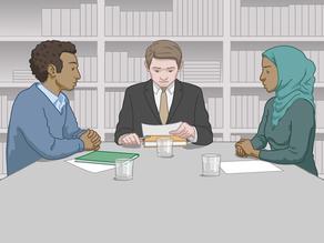 Een man en een vrouw zijn bij de notaris om de echtscheidingsdocumenten op te stellen.