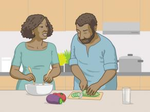 A woman and a man having fun in the kitchen while preparing a meal together