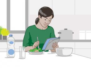 A single woman having a meal at home.
